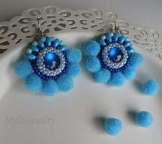 Beaded earings with pompons.