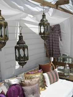 Sunny Patio with Moroccan lanterns and hand embroidered cushions.