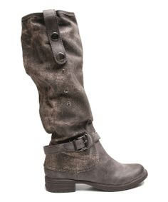 "Rugged yet ravishing, these boots were built for getting the job done gorgeously. A slightly distressed finish with decorative buckle and buttons offers a rustic ""been there, done that"" appeal, while the pull-on design makes them easy to grab and get out the door."