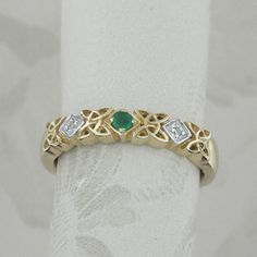 Grant Logan Celtic eternity ring- The three sparkling diamonds in bezel settings draw the eye to this lovely cut out and engraved Celtic ring. Description from pinterest.com. I searched for this on bing.com/images