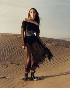 Vittoria Ceretti wears black dress and boots in Alexander McQueen's spring 2017 campaign