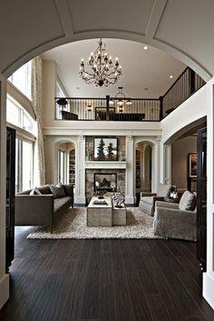 Dark wood floors open plan for classic elegance.- Tuba TANIK