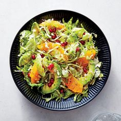 Shredded Brussels sprouts are a great canvas for color, here in the form of ruby-hued pomegranate seeds and navel orange sections. Be sur...