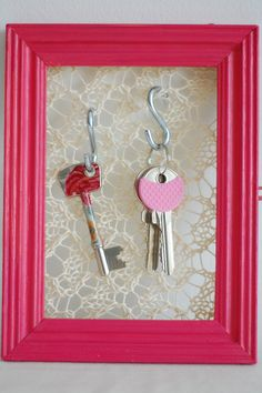 staple lace fabric to the back of a picture frame, add some S hooks to hang the dorm keys for quick, easy access coming and going from the dorm room.