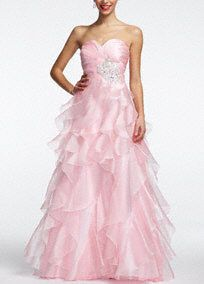 Belle of the ball is an understatement for what you will be in this gorgeous prom dress! Gown features stunning beaded embellishment on hip. Classic ruffle detailing throughout the body of gown provides all the visual drama you are looking for in your prom dress. Fully lined. Side zip. Imported polyester. Spot clean by professional dry cleaner. Available in Plus sizes as Style 11548W.