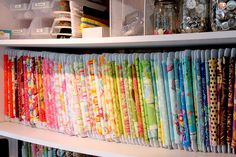 Fabric stored by color on fabric storage cards.
