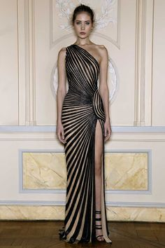 All the diagonal lines create feeling and movement in this dress, and is not conservative. Her hourglass figure makes this dress perfect for her. The hips and shoulders are wider. The visual texture is shiny. It's powerful and very mysterious.