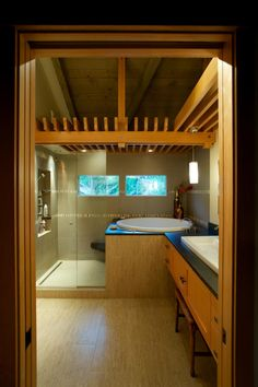 Japanese design sensibility is simple, tranquil and based on natural materials. Because it uses ancient principles of visual harmony, it isn't likely to overstay its welcome in your home. This peaceful Zen bath created by Tenhulzen Residential is anchored by a Japanese soaking tub and fir woodwork.