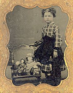 Antique tintype photo of little girl with dolls, circa 1860.