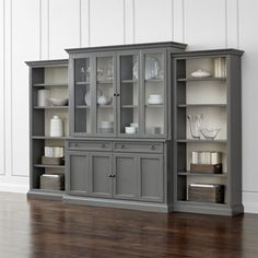Making an extended cameo appearance in the living room, family room or den, this versatile modular wall unit configures beautifully for customized storage, media display and showing off your favorite things. Each well-proportioned piece is handpainted by Italian artisans in a rich, multi-step grey finish with contrasting white interior.