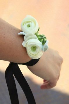 The ribbon tie is an interesting twist on the wrist corsage...