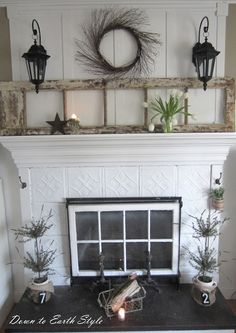 Love this fireplace...the window in the opening, the old ceiling tile look, the hooks on the sides to hang things from and the old french door leaning above.  Beautiful look!