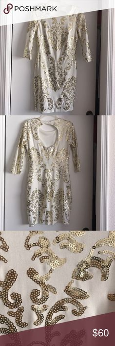 Sexy dress Sexy and classy light cream/white dress with beautiful gold sequins .Front is modest and back has sexy key hole. Size 7/8 I usually wear a size small or 6 this fits perfect. Worn only 1 time for a few hours. b.darlin Dresses Mini