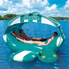 The Floating Cabana - would be awesome at the lake! I need this and someone to blow it up;)