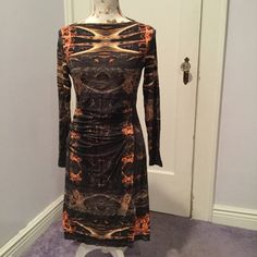 Nicole Miller dress size l large Nicole Miller dress size l large. Has tiny hole that can be sewn other wise great condition. Runs tight Nicole Miller Dresses