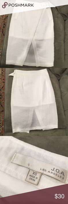 J.O.A white asymmetric skirt Never been worn! It has overlapping panels at front, partial lining, a buckle closure at waist, and zip/hook closures at side. Perfect with a white bodysuit and a tropical vacation. J.o.a Skirts Asymmetrical