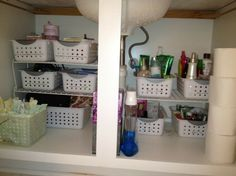 Utilizing not only height, but also using baskets to keep similar items together PLUS labeling - BRILLIANT!!!!!