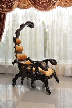 The fearsome Scorpion Chair is a handcrafted wooden chair that is shaped like a scorpion. The chair measures in at six and a half feet and is available with leather upholstery and a variety of wood...wow.