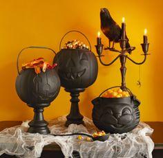 Pumpkin Cauldrons black spray paint ($0.99 – Walmart) + 3 jack o lantern treat pails (Dollar Tree) + creepy cloth (Dollar Tree)