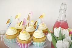 | lemon cupcakes with bird toppers |