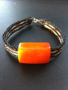 A Taguarte Seed bracelet (Ecuador). A member of the coocnut family, the seeds are dried, peeled, and the hard flesh is revealed. Artisans transform it into jewelry pieces.