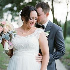 David's Bridal bride Katelyn in a Lace Cap Sleeve Tulle Plus Size Wedding Dress by David's Bridal Collection