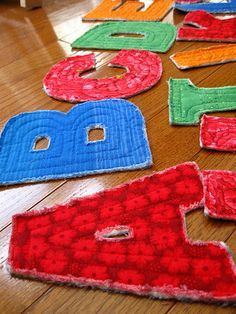 rag quilt letters- would be cute if each letter's fabric had images on it that started with that letter. Ex: apple fabric on letter a