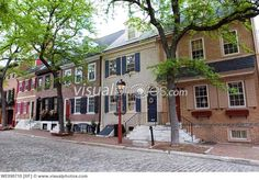 Attractive Georgian brick row house on Delancey Street, a cobblestone street in the Society Hill area of Philadelphia