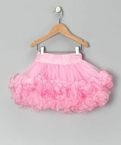 tutututu  ( I love things that puzzle me.  This tutu has ruffled edges.  Did the designer attach the edge before sewing?  I cannot tell.)