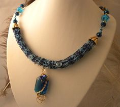 Navy and Aqua Viking Knit with Blue Crystal Pendant by talpal2