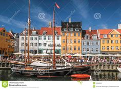 pictures of houses and boats | Old boats and colorful houses in Nyhavn in Copenhagen, Denmark.