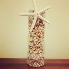 Dollar store vase, seashells, twine, burlap and a starfish. A great DIY to any beach theme party or occasion. I made this for decoration to go along  with my beach theme Christmas.