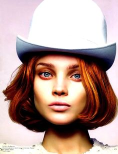just loving the colors between her hair, eyes, makeup, hat, background