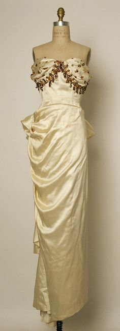Evening dress  Jacques Fath  (French, 1912–1954)  Design House: House of Jacques Fath (French, founded 1937) Date: 1948