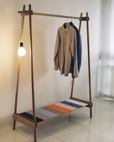 ana kras. DIY clothes rack. Easy DIY for yard sale rack and since my yard is a slope one side can have longer poles to compensate and keep it from falling over when loaded!