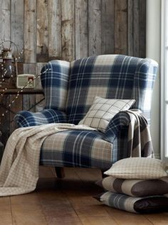 There is something oddly appealing and cozy about a tartan chair (♥ the tiny radio and pussywillows too). I would add a leather ottoman and change the pillows to something softer, maybe floral instead of checks or stripes? Tartan Chair, Plaid Couch, English Cottage, Scottish Decor, Style Anglais, Shed Interior, Leather Ottoman, Wing Chair, Chairs