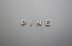Pine.   Pine is a finely crafted typeface meant to embody the strength and elegance of nature. Laser cut from wood, each character has rich physicality while maintaining graphic sophistication.