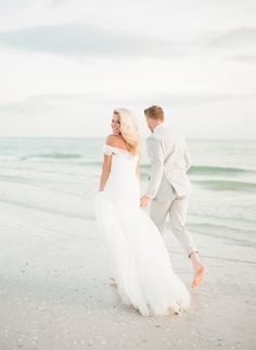 Run on the beach and play in the ocean with the one you love.  Location, Marco Island Marriott; photography, Aaron Snow Photography; bride's attire, JJ Kelly; groom's attire, J.Crew; cinematography, PenWeddings.