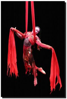 trapeze acrobat | arial acrobat dangling from red silk scarf material