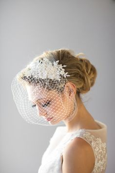Birdcage Veil    This is a handcrafted 9 veil made from quality Russian netting. The focal piece of this veil is gorgeous french corded lace