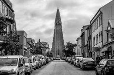 Reykjavik Street by chriswtaylor  street church tower cars road cathedral clock mono Iceland Reykjavik Hallgrímskirkja black & whi