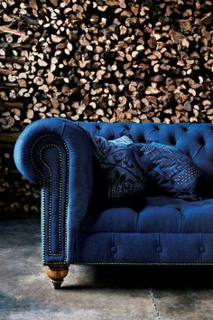 Classic English Chesterfield Tufted Sofa from RL Home in richly hued denim with nine hand-painted throw pillows.