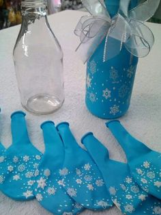 Balloons stretched over bottle or carafe. ... cute table decorations