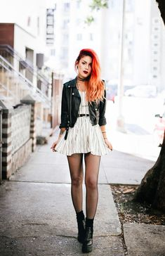 Le Happy wearing JOA dress with black biker jacket and chunky Public Desire Karmen boots