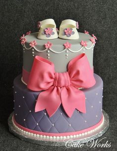 Cake Works: pink, purple, gray quilted baby shower cake with pink bow.  https://www.facebook.com/photo.php?fbid=520160701369911