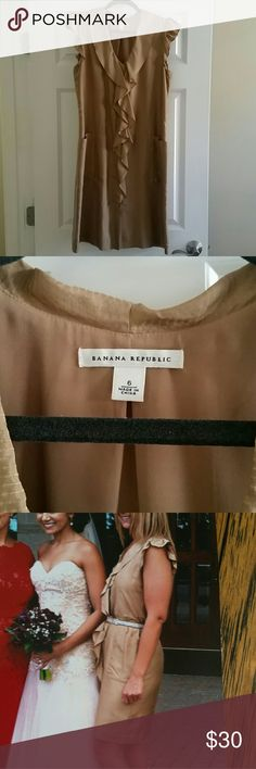 Banana Republic gold dress Gold button down dress. Ruffled sleeves and front. Side deep pockets. 100%silk lining 100% polyester. I dressed it up with heels and flats. But the nice thing about this piece is you can wear ANY belt you want. It seriously is a nice piece. Banana Republic Dresses