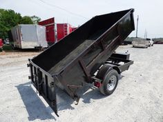 This single axle dump trailer has brakes, a hydraulic lift system with remote controller, and a spreader gate. Dump Trailers, Flatbed Trailer, Trailer Plans, Trailer Build, Monster Trucks, Gate, Welding Projects, Farms, Concrete