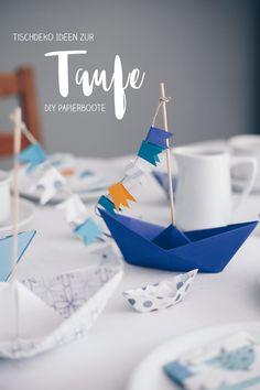DIY Tischdeko zur Taufe mit Booten - Papierboote falten - Origamit Boote mit Wimpeln als Tischdeko nutzen. Moderne Deko zur Taufe selbermachen. Ideen für die Tauffeier basteln.
