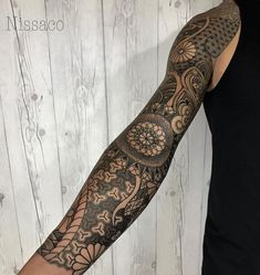 Mind blowing arm sleeve tattoo.