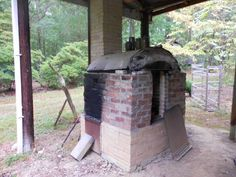 """Judy Touchstone's wood-fired kiln, GA, designed from """" The Kiln Book"""" with added cone sitter from old electric kiln and a chimney shutoff right behind the ware floor."""